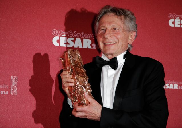 In this Feb. 28, 2014 file photo, Polish-French film director Roman Polanski holds his best director award during the 39th French Cesar Awards Ceremony in Paris.