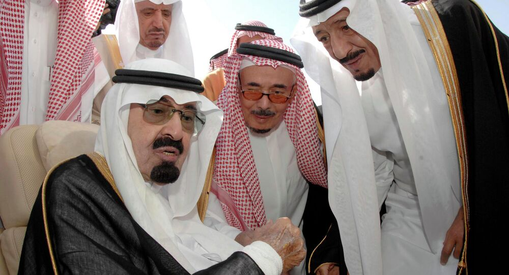 Saudi Arabia's King Abdullah, left, speaks with his half-brother Salman, who has been appointed King following Abdullah's death early Friday.