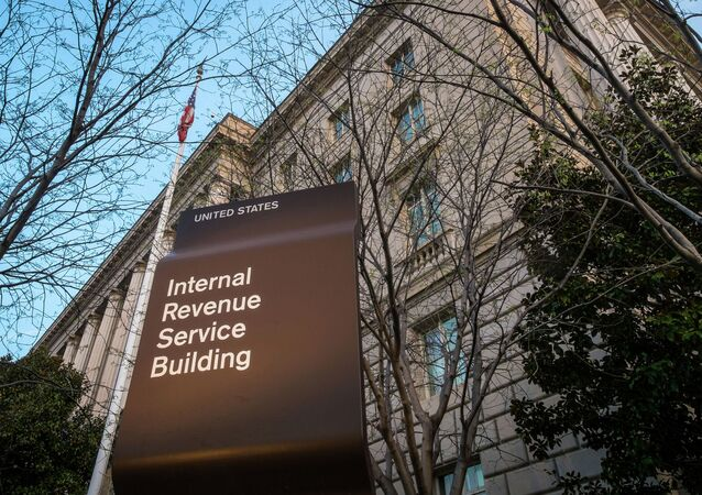 In this April 13, 2014 file photo, the Internal Revenue Service Headquarters (IRS) building is seen in Washington. The IRS is cutting taxpayer services to historically low levels just as President Barack Obama's health law will make filing a federal tax return more complicated for millions of families.