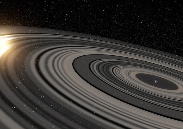 "Artist's rendering of a ""super Saturn"" in a distant solar system recently found to have rings big enough to eclipse its own sun."