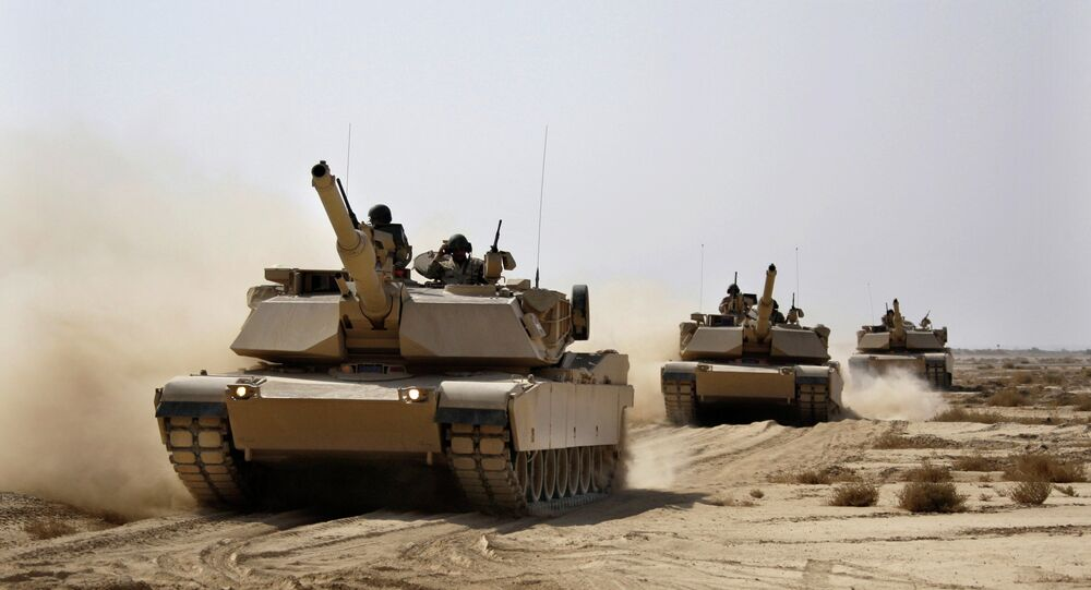 Iraqi Army M1 Abrams tanks, purchased from the U.S., maneuver during a live fire exercise outside Baghdad.