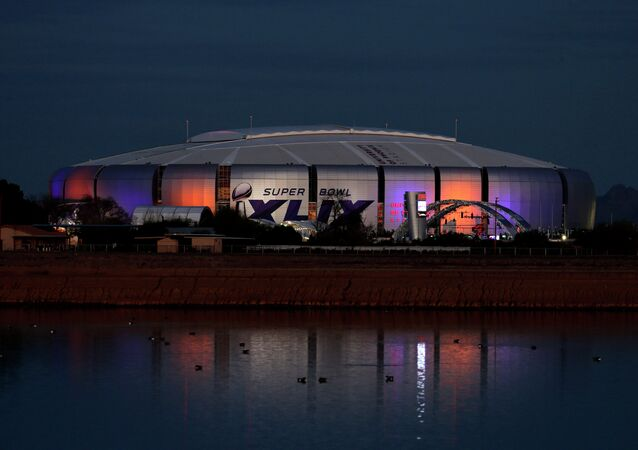The Super Bowl XLIX logo is displayed on the University of Phoenix Stadium, Tuesday, Jan. 27, 2015, in Glendale, Ariz. The New England Patriots face the Seattle Seahawks in Super Bowl XLIX on Sunday, Feb. 1, in Glendale.