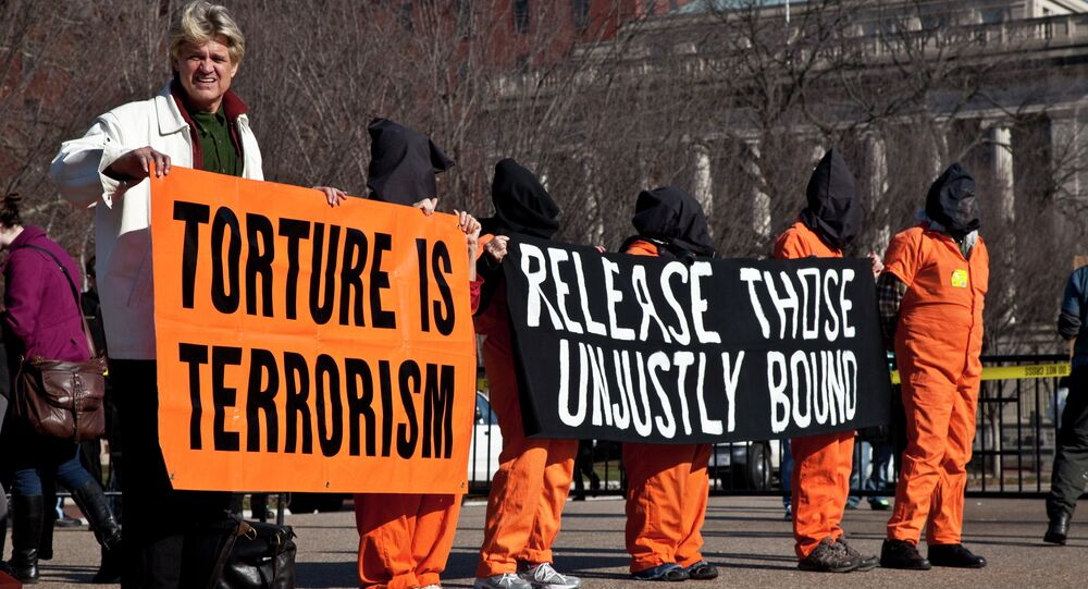 People protest torture outside of the White House in Washington, DC.