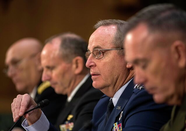 Air Force Chief of Staff Gen. Mark Welsh III, second from right, responds to questions from Senate Armed Services Committee member Sen. Kelly Ayotte, R-N.H., as he testifies on Capitol Hill in Washington, Wednesday, Jan. 28, 2015, before the committee's hearing on the impact of the Budget Control Act of 2011 and sequestration on national security. From left are, Army Chief of Staff Gen. Raymond Odierno, Chief of Naval Operations Adm. Jonathan Greenert, Welsh, and Marine Corps Commandant Joseph Dunford, Jr.