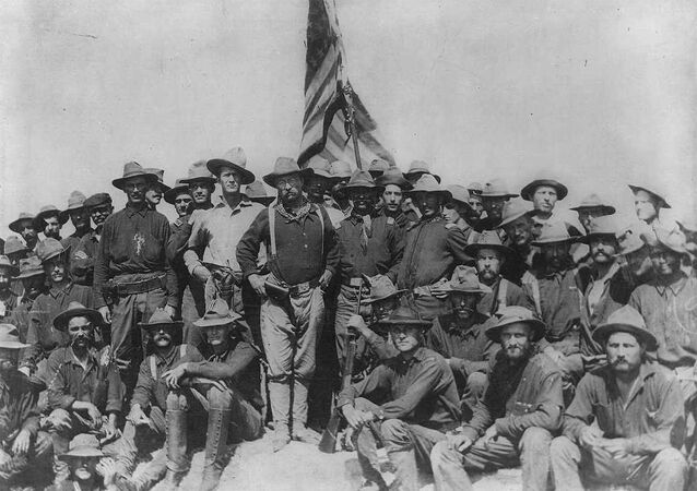 Col Theodore Roosevelt stands triumphant on San Juan Hill, Cuba after his Rough Riders captured this hill and its sister Kettle Hill during the Spanish American War.