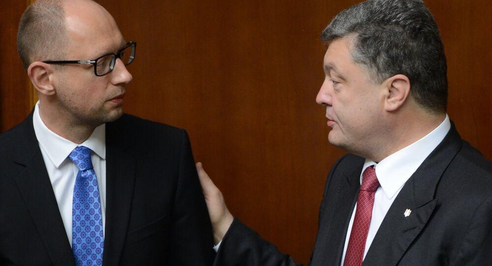 Ukrainian President Petro Poroshenko (right) and Prime Minister Arseny Yatsenyuk (left)