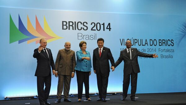 On July 15, 2014, BRICS leaders -- Russian President Vladimir Putin, Indian Prime Minister Narendra Modi, Brazilian President Dilma Rousseff, Chinese President Xi Jinping and South African President Jacob Zuma (from left to right) -- pose for a group photo in the Congress Center in Fortaleza. - Sputnik International