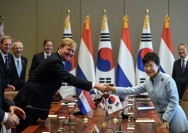 King Willem Alexander of the Netherlands shakes hands with South Korean President Park Geun-hye prior to a meeting at the Presidential Blue House in Seoul, November 3, 2014