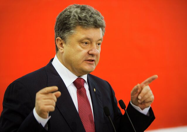 Ukraine's President Petro Poroshenko delivers a speech during a meeting with members of his party, Petro Poroshenko's political bloc, in Kiev, in this October 31, 2014 handout photo provided by the Ukrainian Presidential Press Service