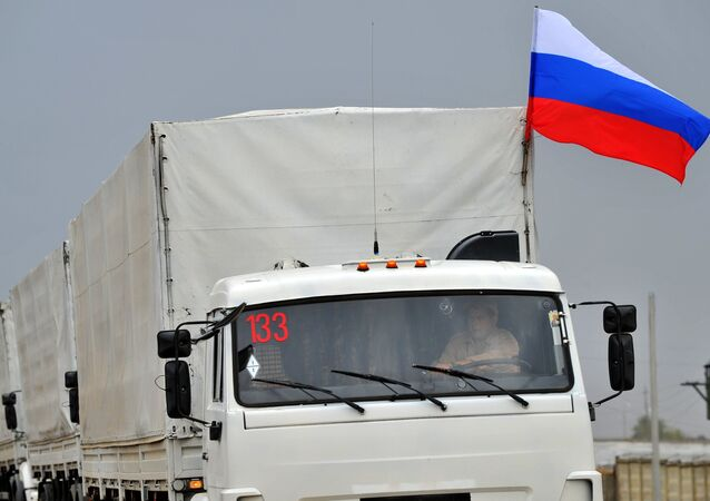 Trucks of a Russian convoy carrying humanitarian aid for Ukraine drive onto the territory of Russia-Ukraine border crossing point Donetsk in Russia's Rostov Region