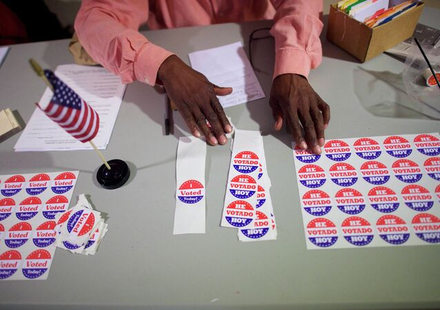 A majority inspector arranges 'I Voted Today!' stickers at registration on U.S. midterm election day morning at Holmes School Senior Center in Philadelphia, Pennsylvania, November 4, 2014