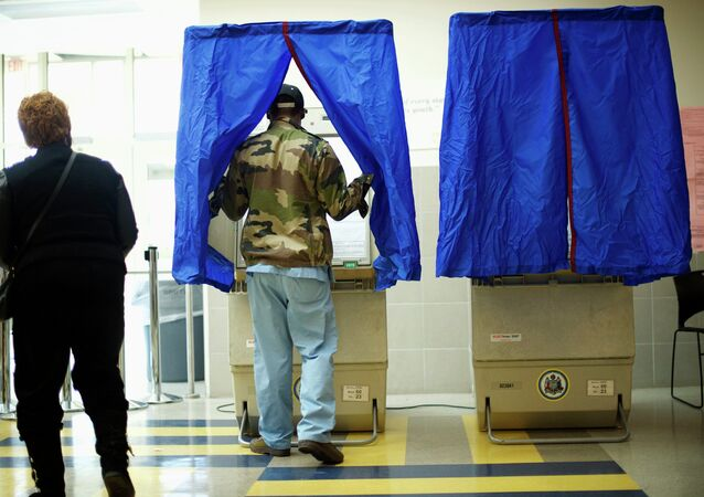 A man enters a voting booth at West Philadelphia High School on U.S. midterm election day morning in Philadelphia, Pennsylvania, November 4, 2014