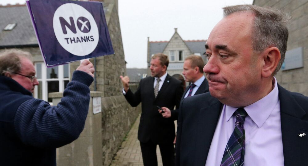 Scotland's First Minister Alex Salmond, looks on at a No campaigner sign during a walkabout in Ellon, Scotland, Thursday, Sept. 18, 2014