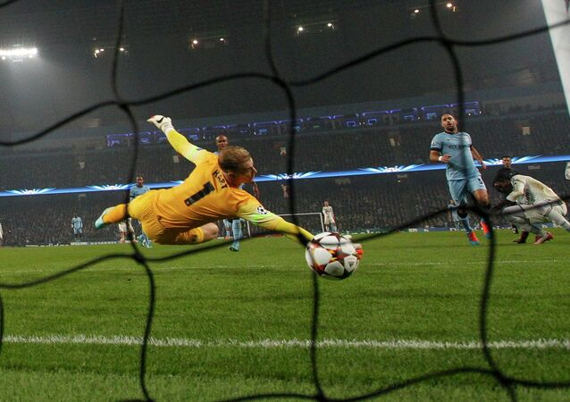 Manchester's City's goalkeeper Joe Hart (front) fails to save a goal by CSKA Moscow's Seydou Doumbia during their Champions League soccer match at the Etihad stadium in Manchester, northern England November 5, 2014