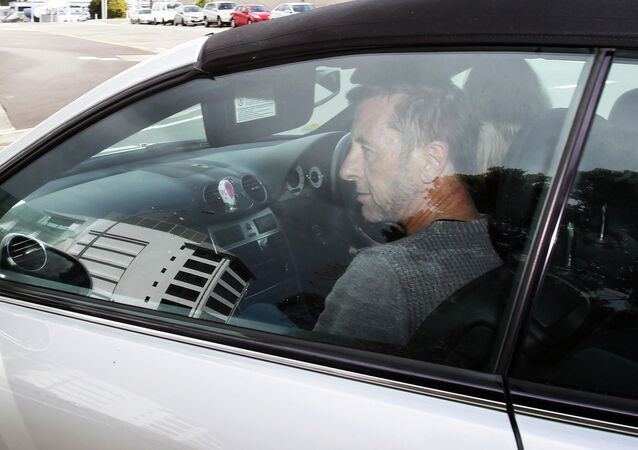 AC/DC drummer Phil Rudd leaves Tauranga District Court after being charged with attempting to procure murder at Tauranga District Court on November 6, 2014 in Tauranga, New Zealand