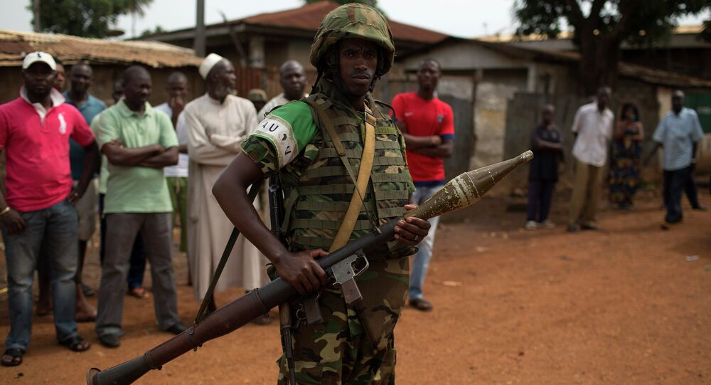 An African Union (AU) soldier stands guard outside a home in the Muslim neighbourhood of Kilometre 5 (PK5) in the capital Bangui