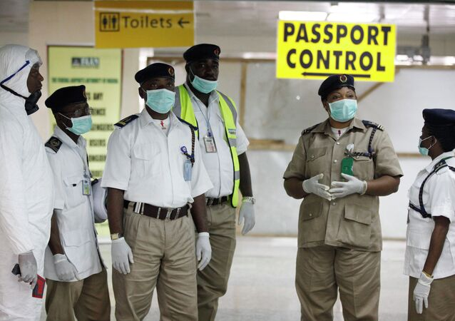Health service workers are waiting for passengers at a Nigerian airport