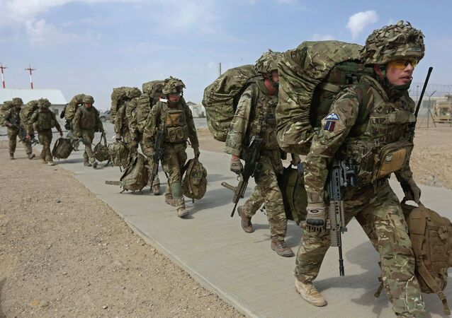 British troops prepare to depart upon the end of operations for US Marines and British combat troops in Helmand.