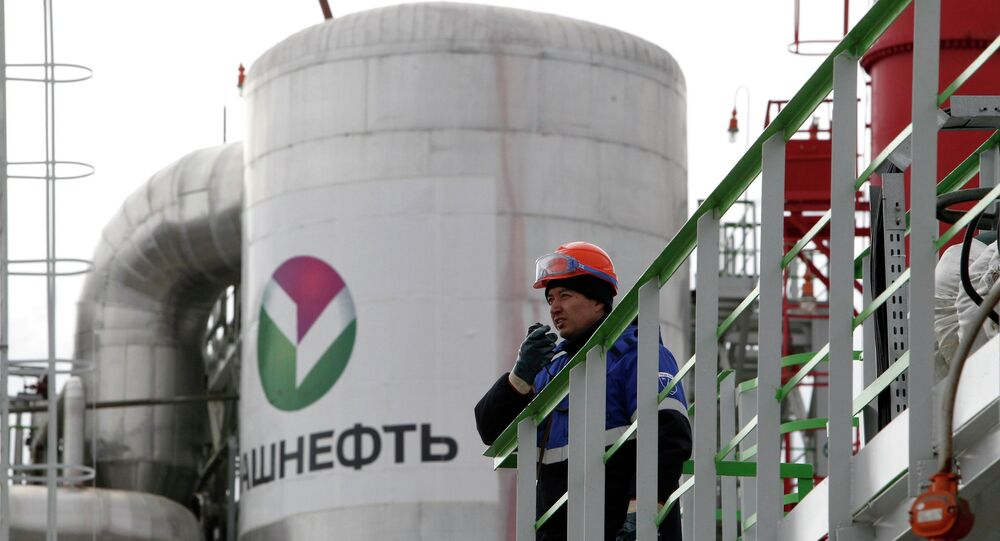 An employee talks on a portable radio set at a refinery owned by Bashneft company in the city of Ufa