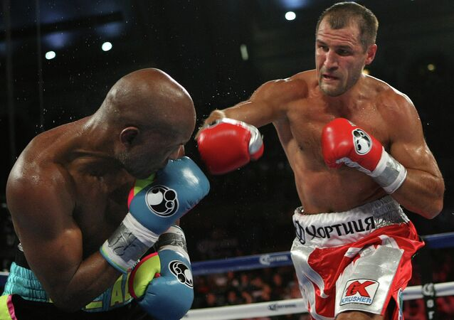 Bernard Hopkins of Philadelphia, PA, left, gets hit by Sergey Kovalev of Russia during the fifth round of the Main Event IBF, WBA and WBO Light Heavyweight Titles boxing in Atlantic City