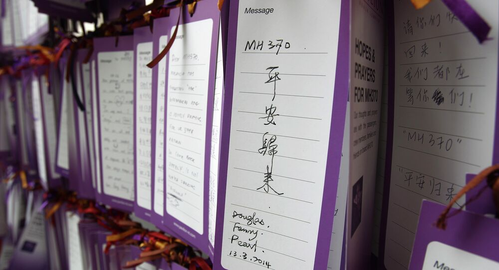 A message card reading MH370 comes back safely is tied up for passengers aboard a missing Malaysia Airlines plane. (File)
