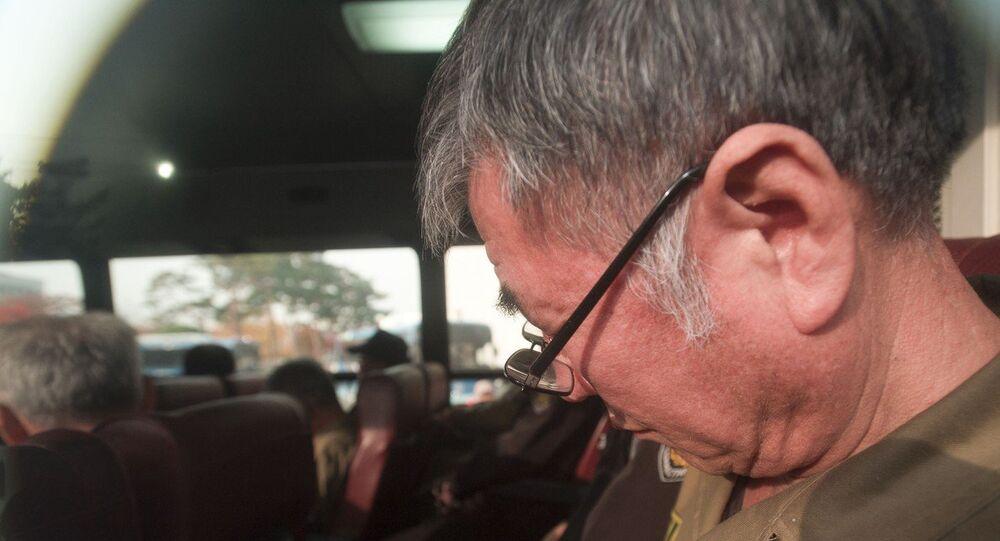 Lee Joon-seok, the captain of the sunken South Korean ferry Sewol, on the bus, arrives for verdict and sentence session at Gwangju District Court in Gwangju, South Korea, Tuesday, Nov. 11, 2014