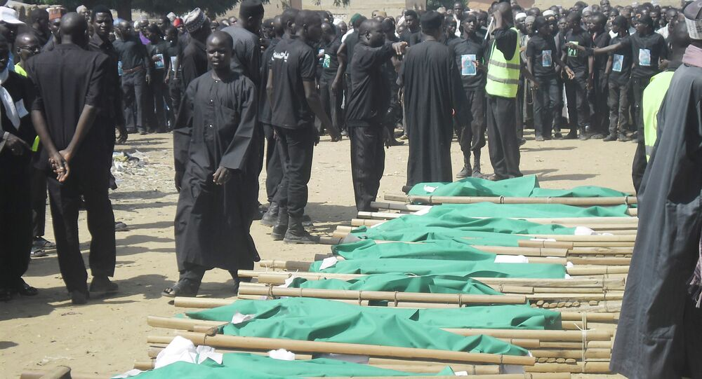 People prepare bodies of victims of a suicide bomb explosion for burial in Potiskum, Nigeria,Tuesday, Nov. 4, 2014