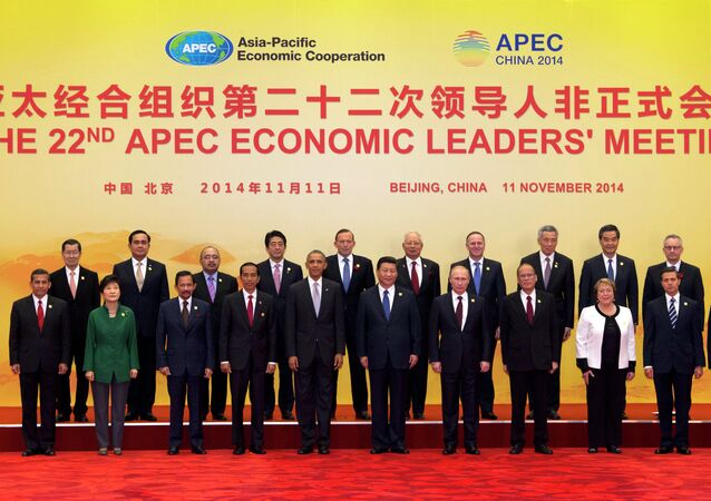 Leaders pose for a group photo at the Asia-Pacific Economic Cooperation (APEC) summit at the International Convention Center in Yanqi Lake, Beijing, on Tuesday, Nov. 11, 2014