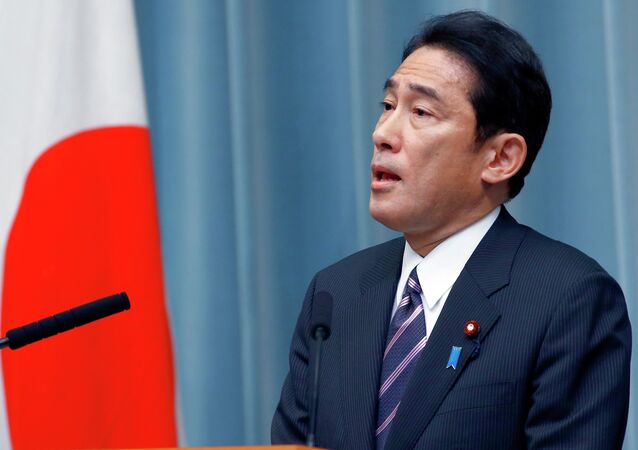 Foreign Minister Fumio Kishida speaks during a press conference at the prime minister's official residence in Tokyo, Wednesday, Sept. 3, 2014