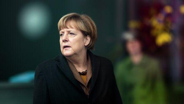German Chancellor Angela Merkel waits for the arrival of Pakistani Prime Minister Nawaz Sharif for talks at the chancellery in Berlin, Tuesday, Nov. 11, 2014 - Sputnik International