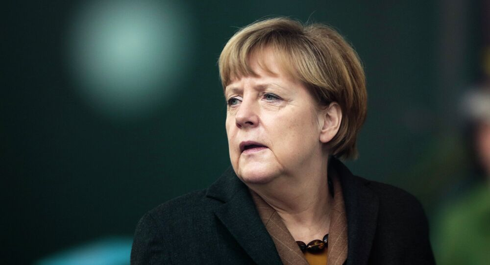German Chancellor Angela Merkel waits for the arrival of Pakistani Prime Minister Nawaz Sharif for talks at the chancellery in Berlin, Tuesday, Nov. 11, 2014