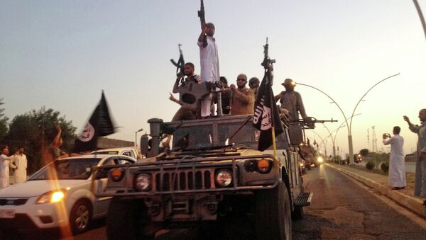 In this file photo taken Monday, June 23, 2014, fighters from the Islamic State group parade in a commandeered Iraqi security forces armored vehicle down a main road at the northern city of Mosul, Iraq. - Sputnik International