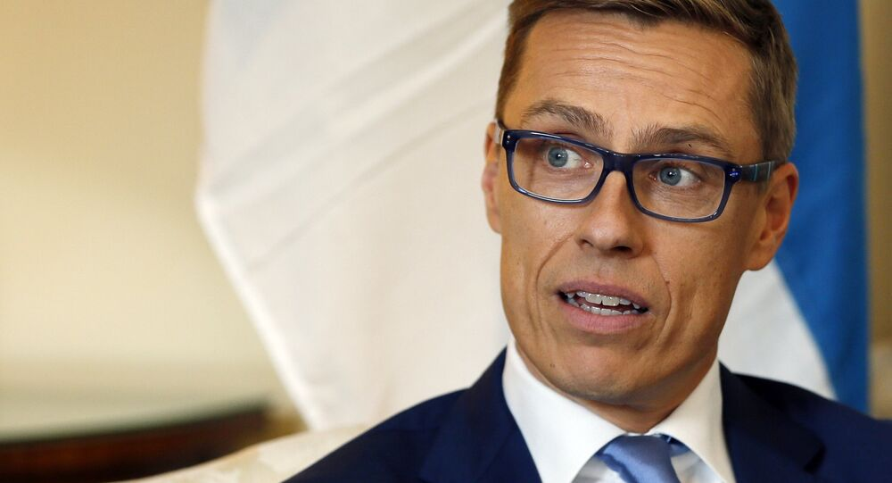 Finland's Prime Minister Alexander Stubb speaks to the media during a meeting with Britain's Prime Minister David Cameron inside 10 Downing Street in London, Wednesday, Oct. 8, 2014