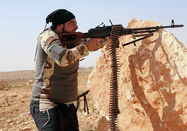 A Free Syrian Army fighter aims his weapon during a battle with Syrian government forces in Aleppo, Syria, Friday, Oct. 3, 2014