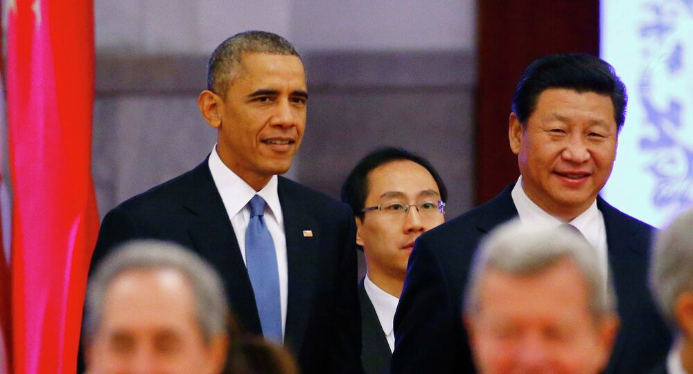 U.S. President Barack Obama (rear L) walks next to China's President Xi Jinping (rear R) as they arrive at a welcoming ceremony at the Great Hall of the People in Beijing, November 12, 2014