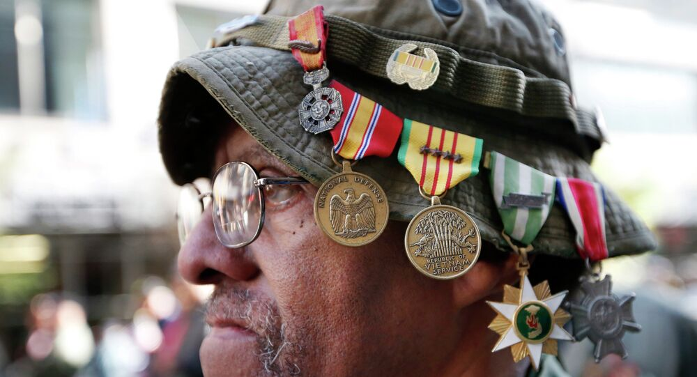 Vietnam veteran Laurence Lynch of Mount Vernon, N.Y., wears his medals on his hat as he marches with other Vietnam veterans during the annual Veterans Day parade in New York, Tuesday, Nov. 11, 2014