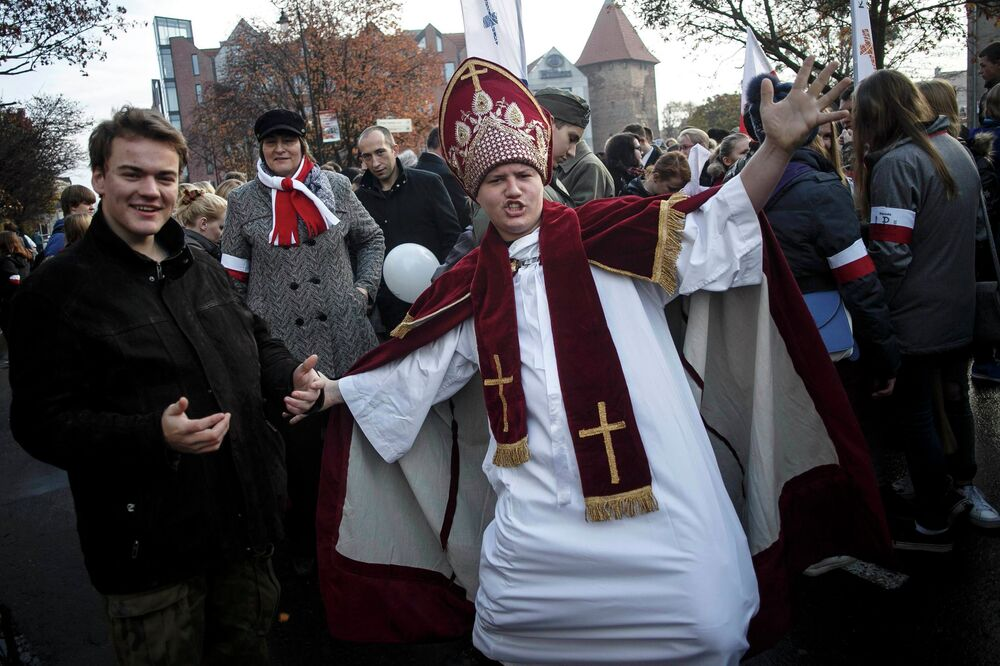 A man pose wearing a pope outfit during the Independence Day celebrations in Gdansk November 11, 2014