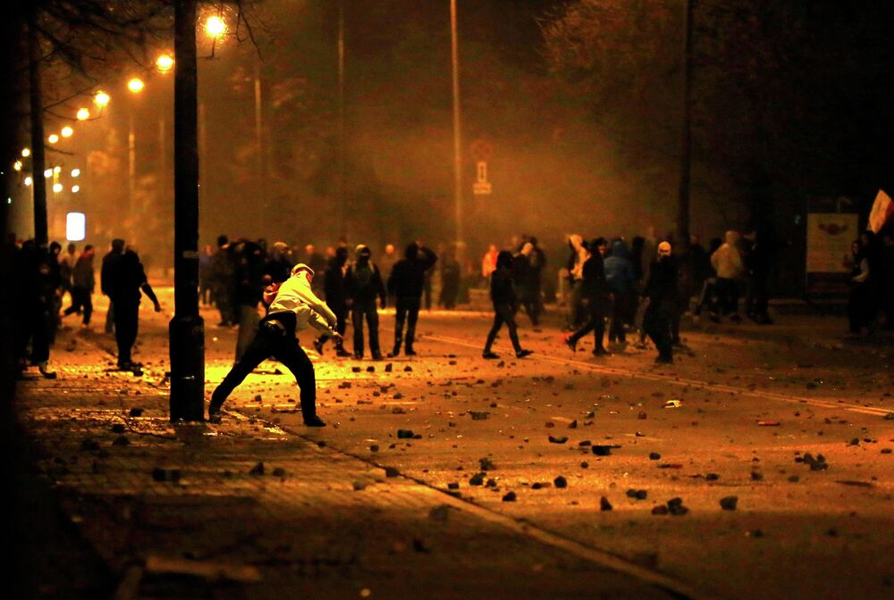 Several hundred masked men threw stones and flares at lines of riot police after they broke away from a far-right march Warsaw November 11, 2014