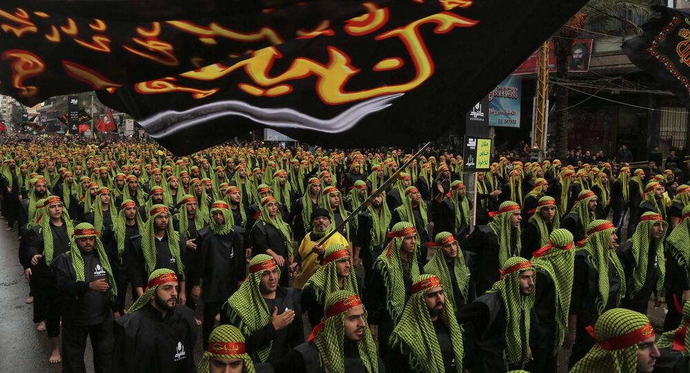 Lebanese Hezbollah supporters march during a religious procession to mark Ashoura in Beirut's suburbs November 4, 2014