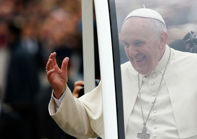 Pope Francis waves as he arrives to lead his weekly general audience in Saint Peter's Square at the Vatican November 12, 2014