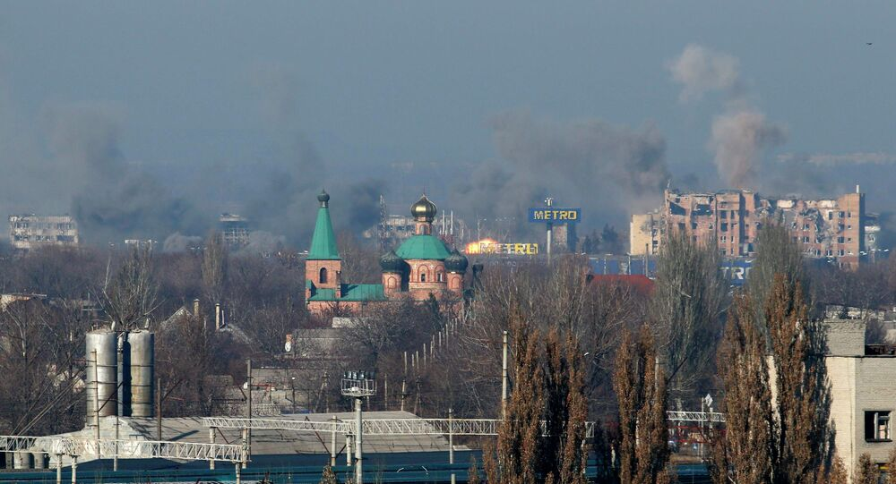 Smoke rises above an old terminal (L) and an administrative building of the Sergey Prokofiev International Airport after the recent shelling