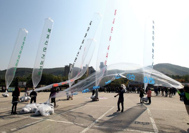 North Koran defectors prepare to release balloons carrying leaflets condemning North Korean leader Kim Jong Un and his government's policies
