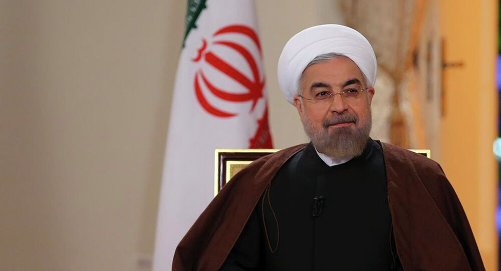 In this photo released by the Iranian Presidency Office, President Hassan Rouhani attends an interview with the state-run TV in Tehran, Iran, on Monday, Oct. 13, 2014