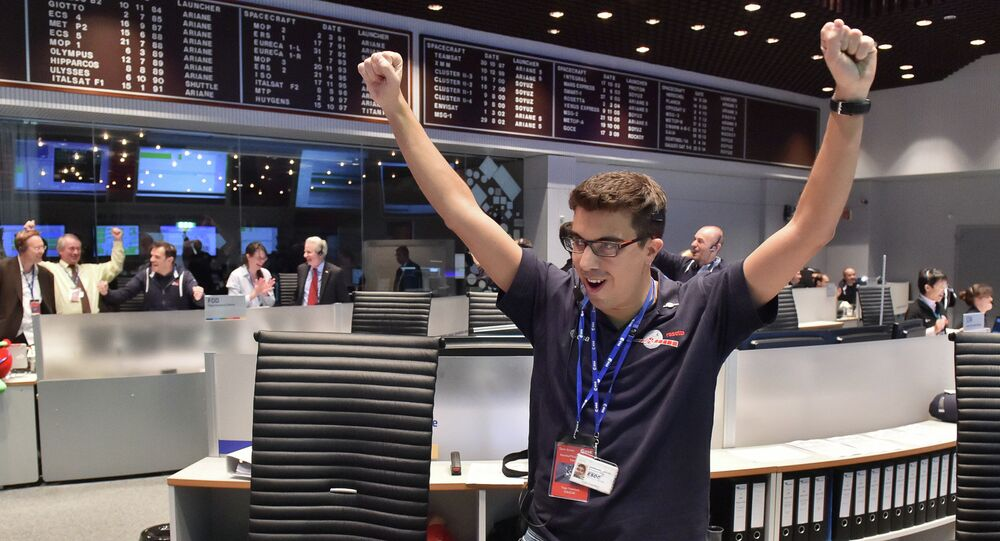 The picture released by the European Space Agency ESA on Wednesday, Nov. 12, 2014, a scientist reacts in the main control room at the European Space Agency after the first unmanned spacecraft Philae landed on the comet called 67P