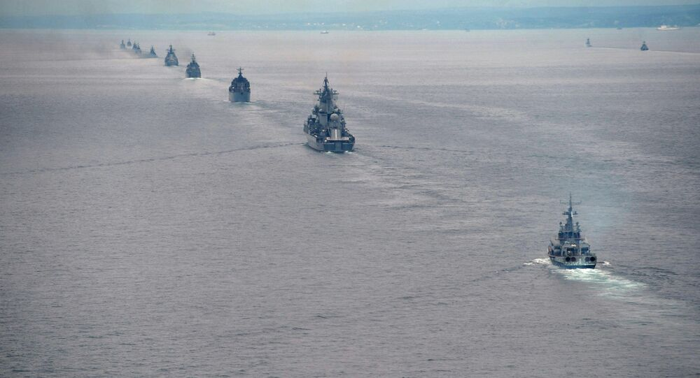 Russian Pacific Navy ships sail near the Sakhalin Island during military exercises on Tuesday, July 16, 2013
