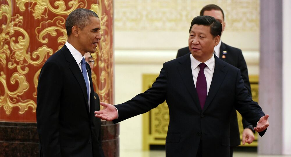 Chinese President Xi Jinping gestures to U.S. President Barack Obama (L) as they arrive for a lunch banquet in the Great Hall of the People in Beijing November 12, 2014