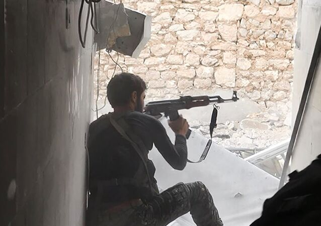 This undated photo posted on Monday, Nov. 4, 2014 by the Raqqa Media Office of the Islamic State group, a militant extremist group, shows an Islamic state group fighter in Kobani, Syria