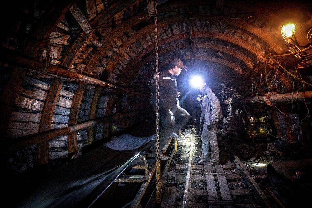 Miners inside the Glubokaya mine in Shakhtyorsk
