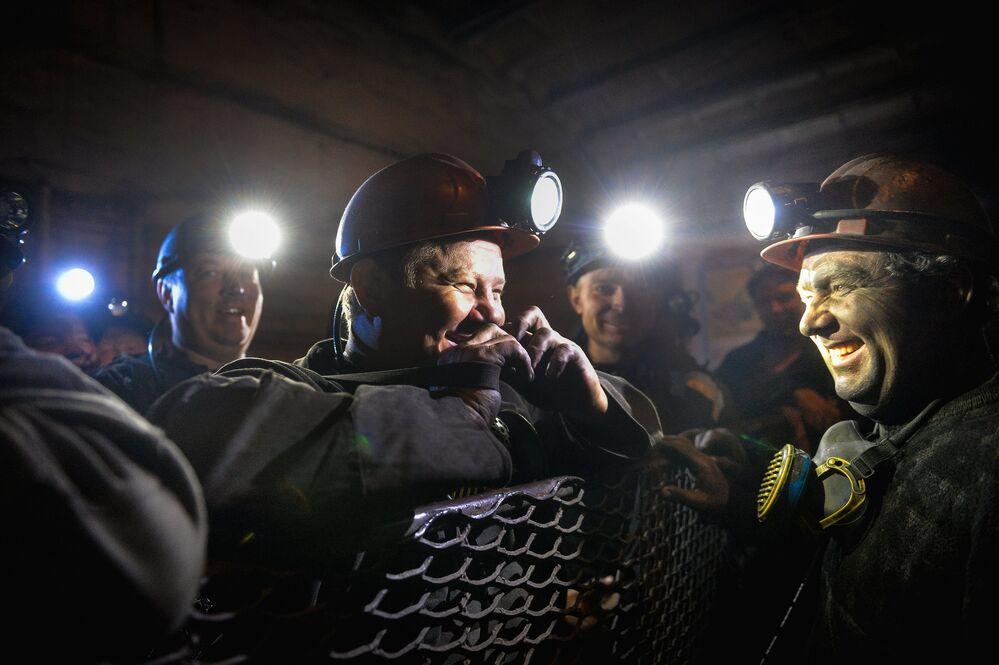 Miners inside the Glubokaya mine