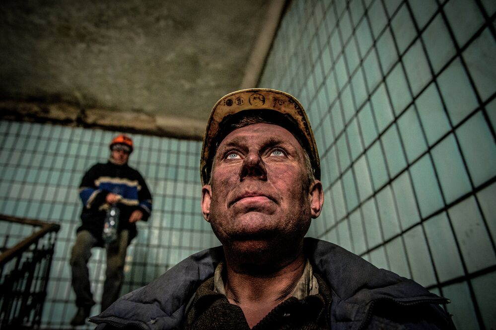 Miners after a shift at the Chelyuskintsev mine in Donetsk